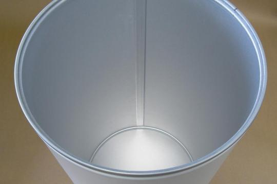 View of the inside of a fibre drum lined with alufoil to eliminate contamination risk