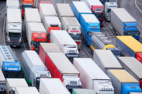 Birdseye view of trucks stuck in traffic at a port