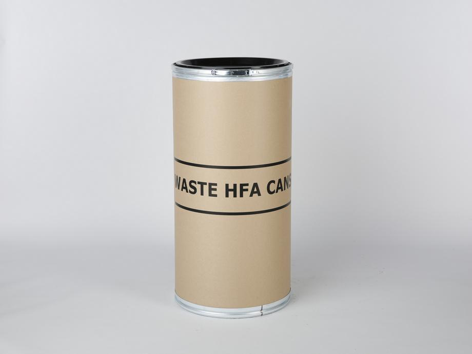 Fibre drum with 'Waste HFA Cans' written on it