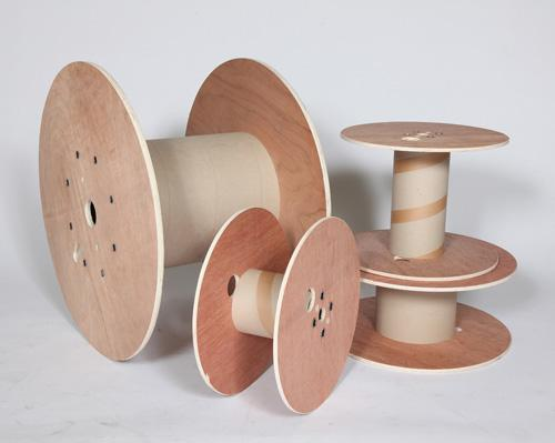 Four wooden cable reels of different dimensions