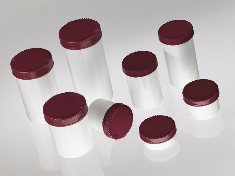 Eight different sizes of small plastic cylindrical containers with lids