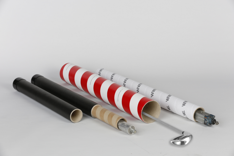 Four long cardboard tubes of different designs with golf clubs inside