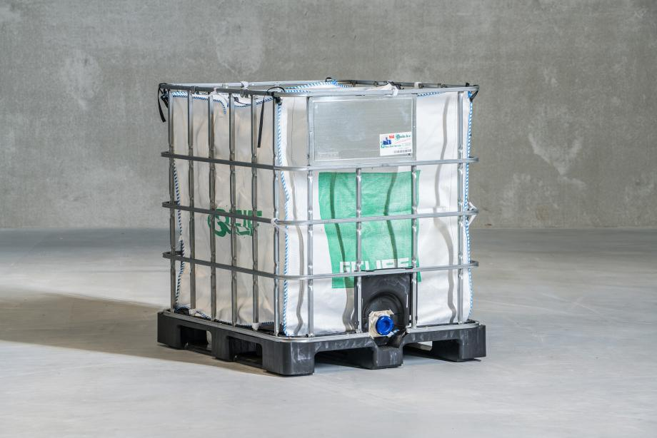 Flexible aseptic 1000 litre bag inside a metal cage on a pallet