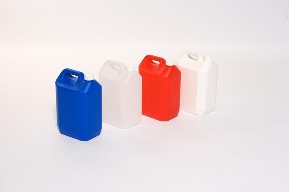 Four plastic jerricans in different colours