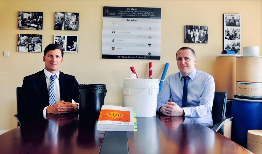 Rob Lee and Graham Kennedy DGSAs in their office demonstrating packaging options