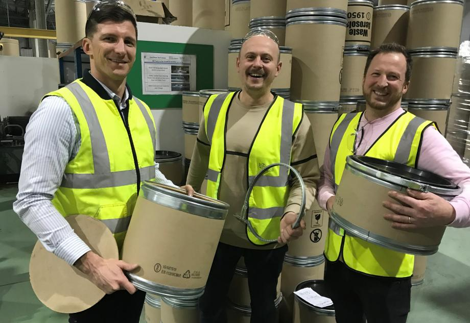 Robert, Frank and Peter, holding small fibre drums