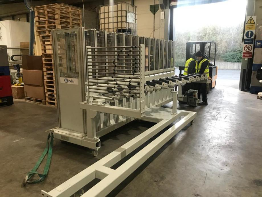 New core winding machine being delivered to factory by forklift