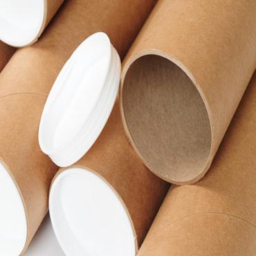 Close up of 5 cardboard tubes in natural colour with white plastic caps.