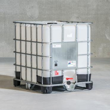 White plastic IBC tank, in a metal cage, on a black composite pallet.