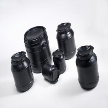 6 black plastic drums in various sizes, which protect UV sensitive product.