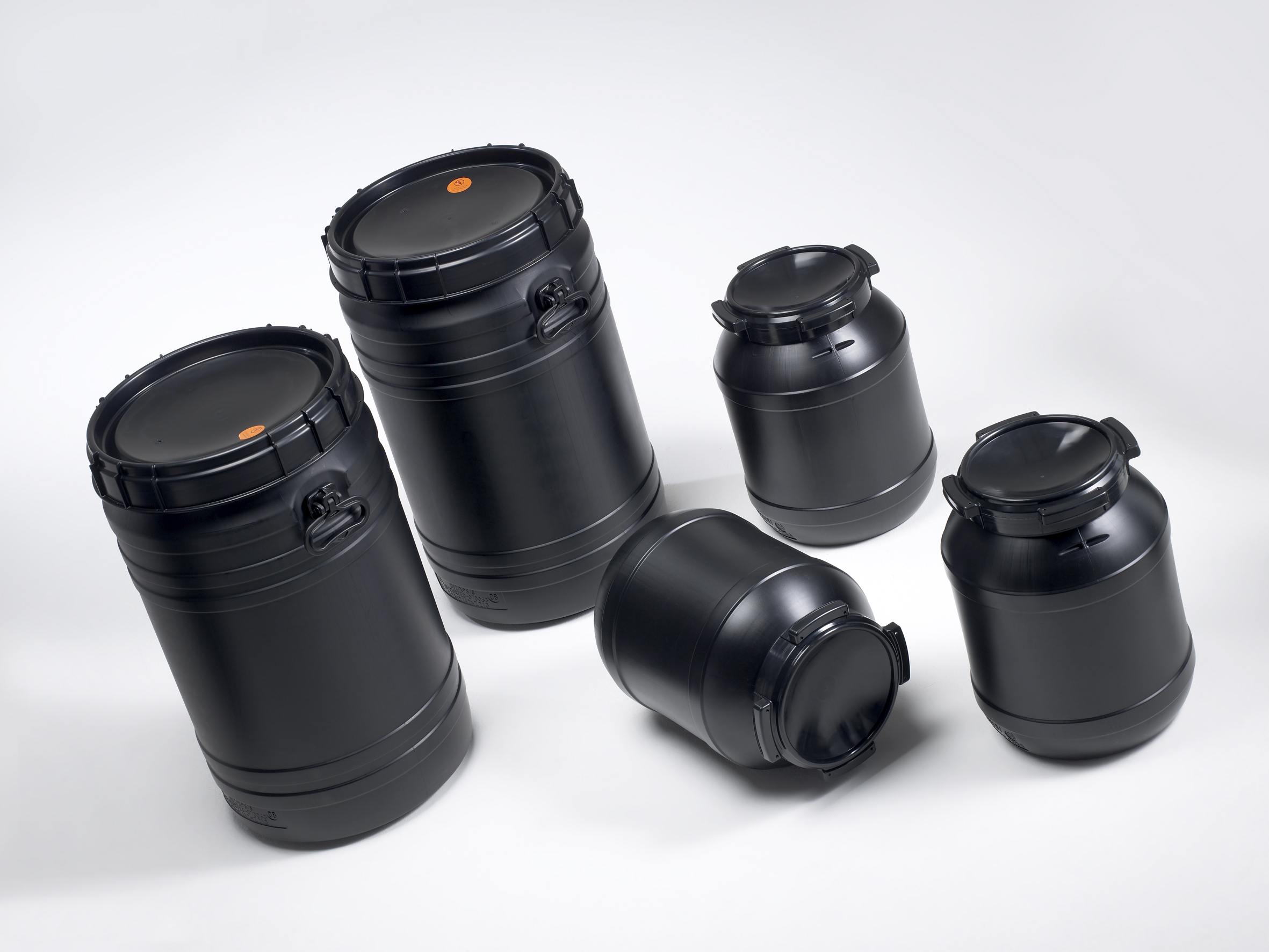 Five black plastic drums of different sizes, specially designed to contain flammable contents