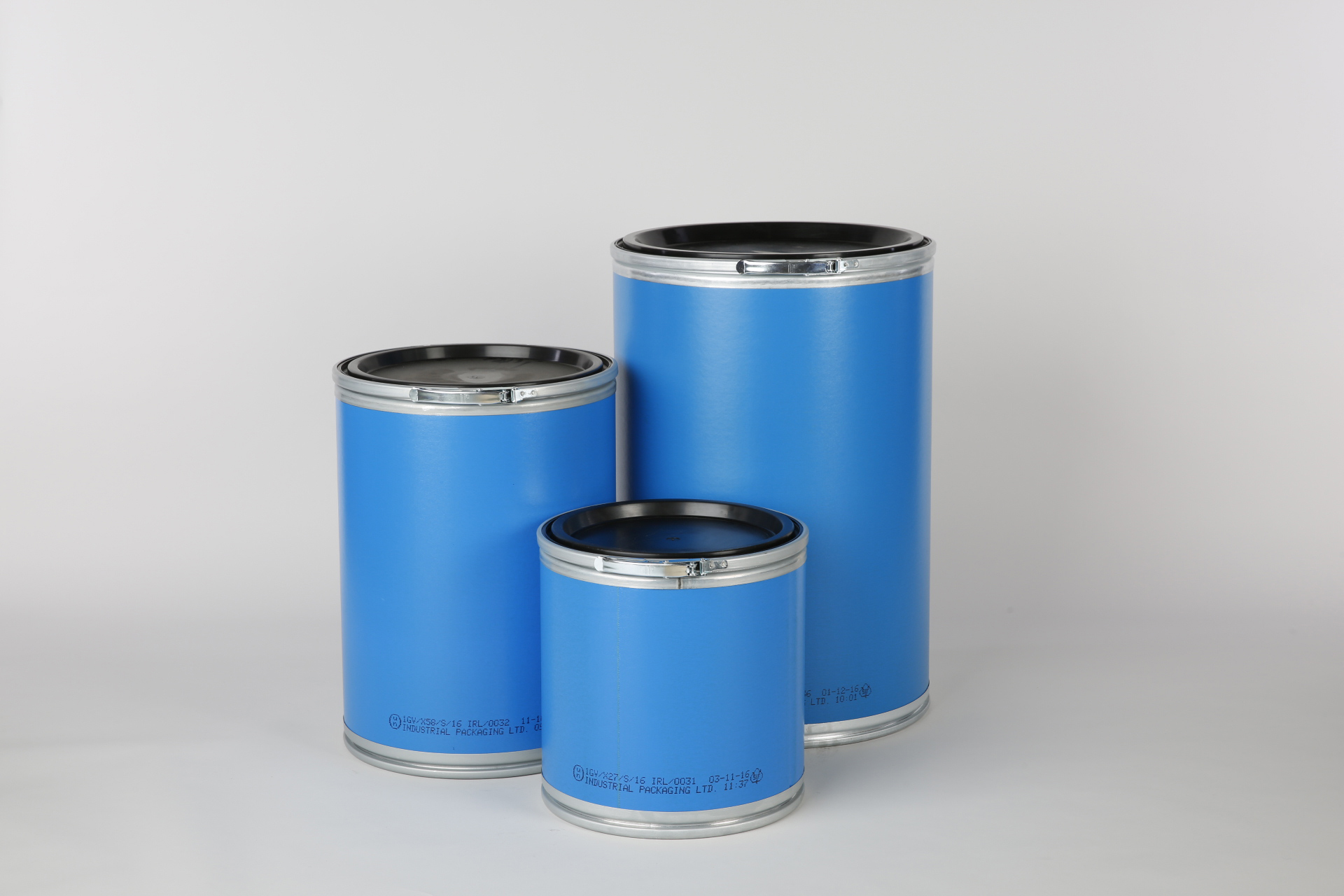 Three blue fibre drums of different sizes